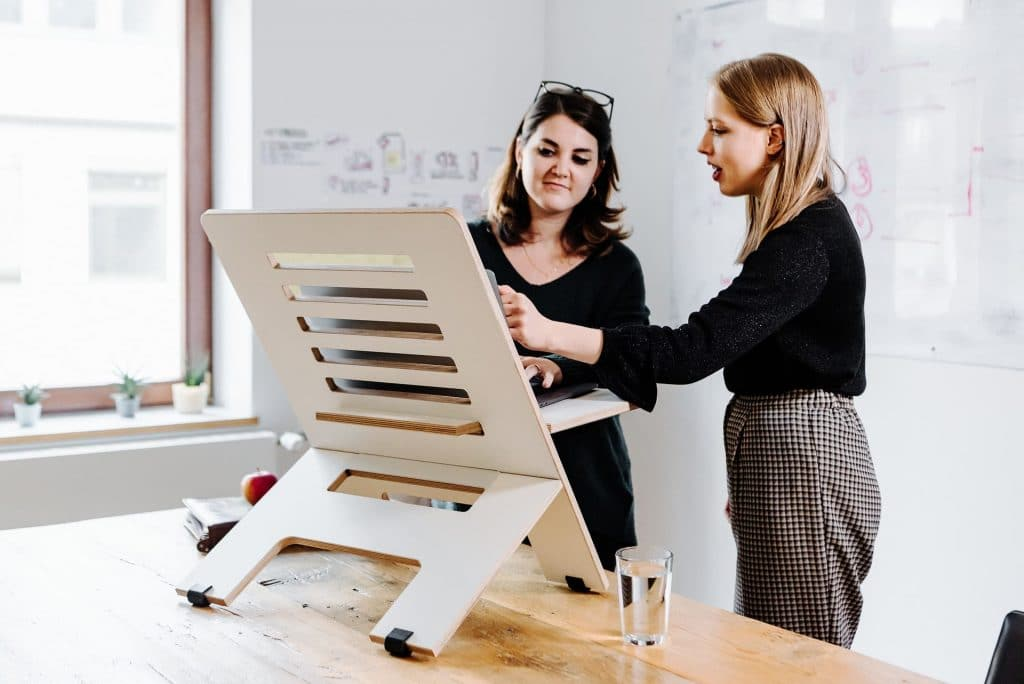 stand up desk converter with two women