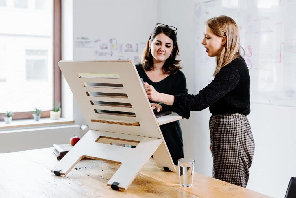 two women and standing desk