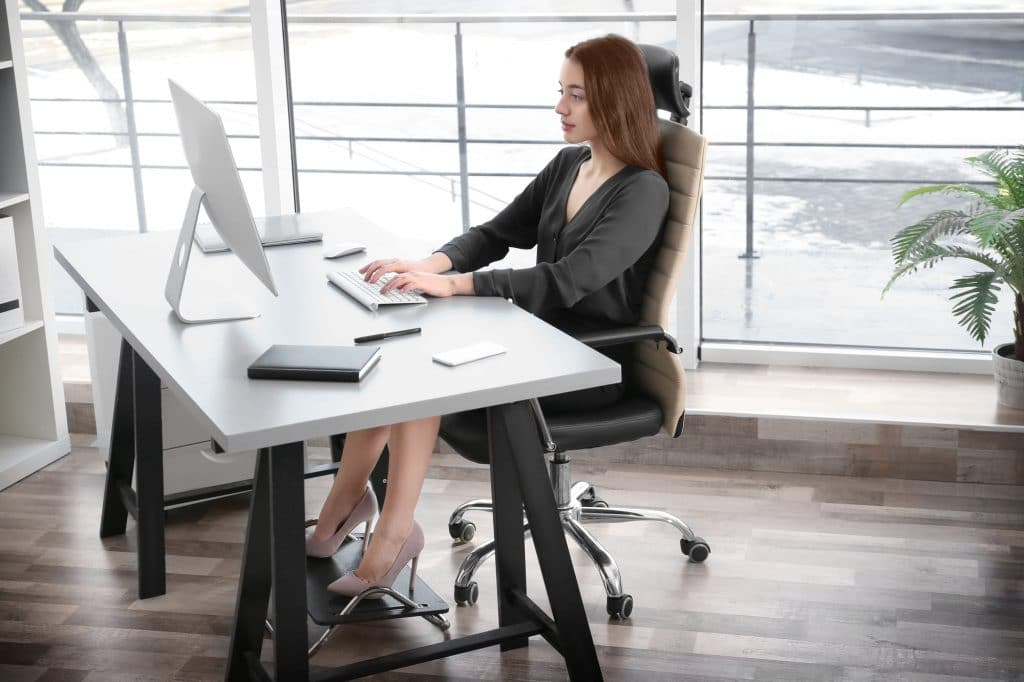 best office chair accessories women in front of pc with footrest