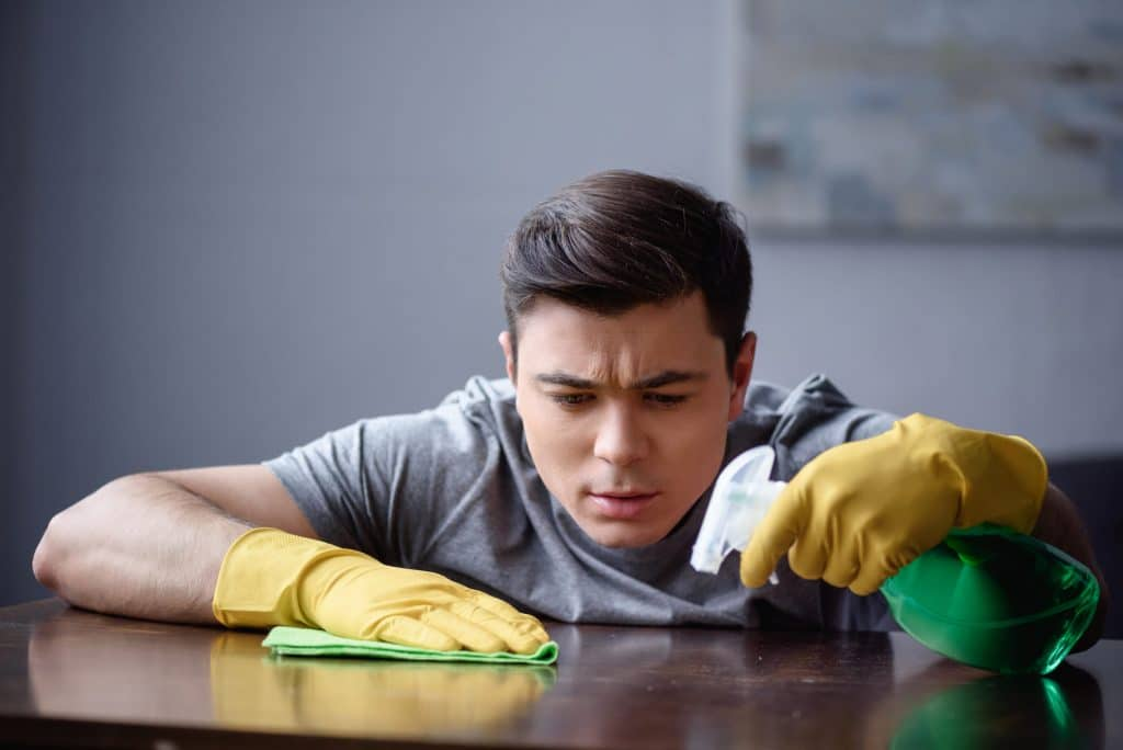 man cleaning desk