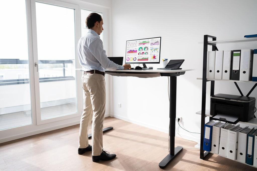 man in front of standing desk
