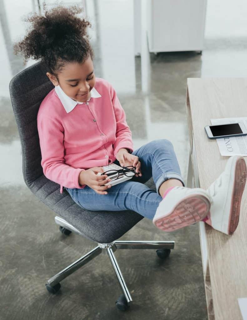 girl sitting aonkids desk chair