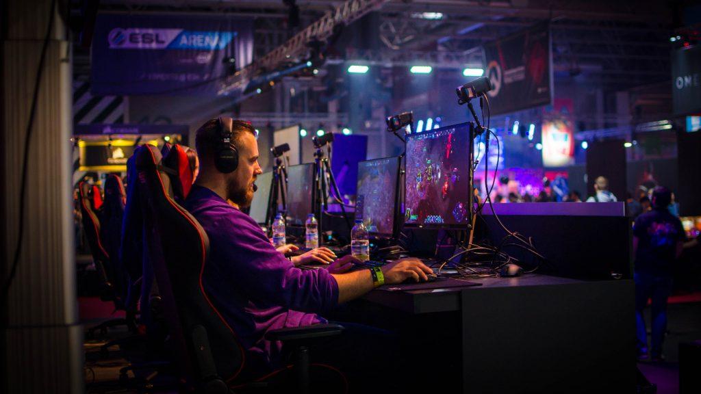 man sitting at computer gaming esports