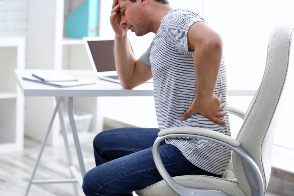 does standing help lower back pain featured image