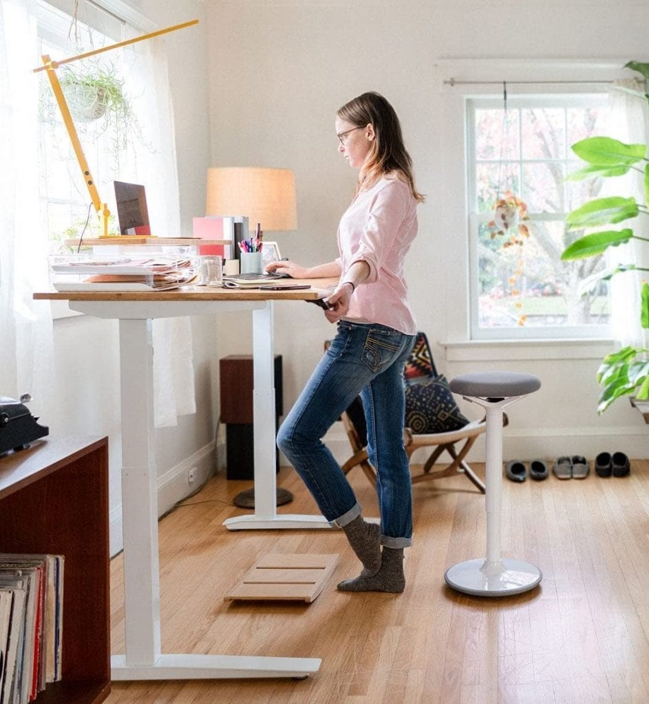 woman in front of fully jarvis bamboo desk